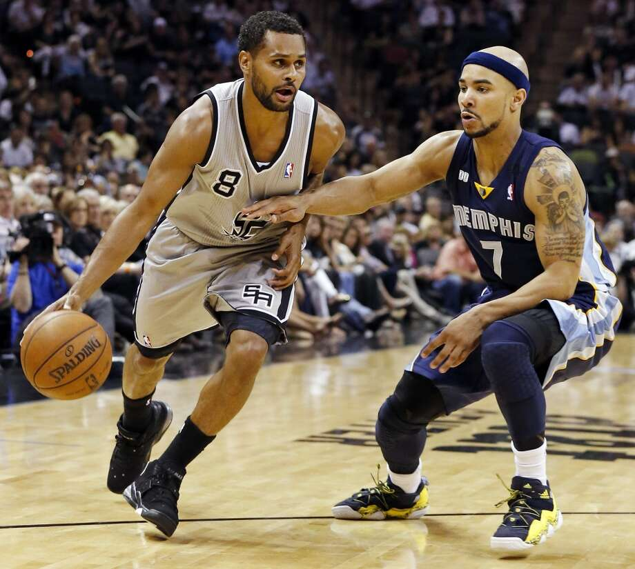 The Spurs' Patty Mills looks for room around the Grizzlies' Jerryd Bayless during the 2013 Western Conference Finals on May 19, 2013 at the AT&T Center. The Spurs won 105-83.