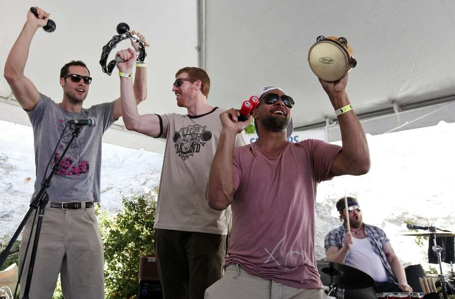"Luke Bonner (from left) the Spurs' Matt Bonner and Patty Mills perform with Reverend Peyton's Big Damn Band at the ""Sneakers & Speakers"" concert at Club De Ville during South by Southwest on March 13, 2013 in Austin."