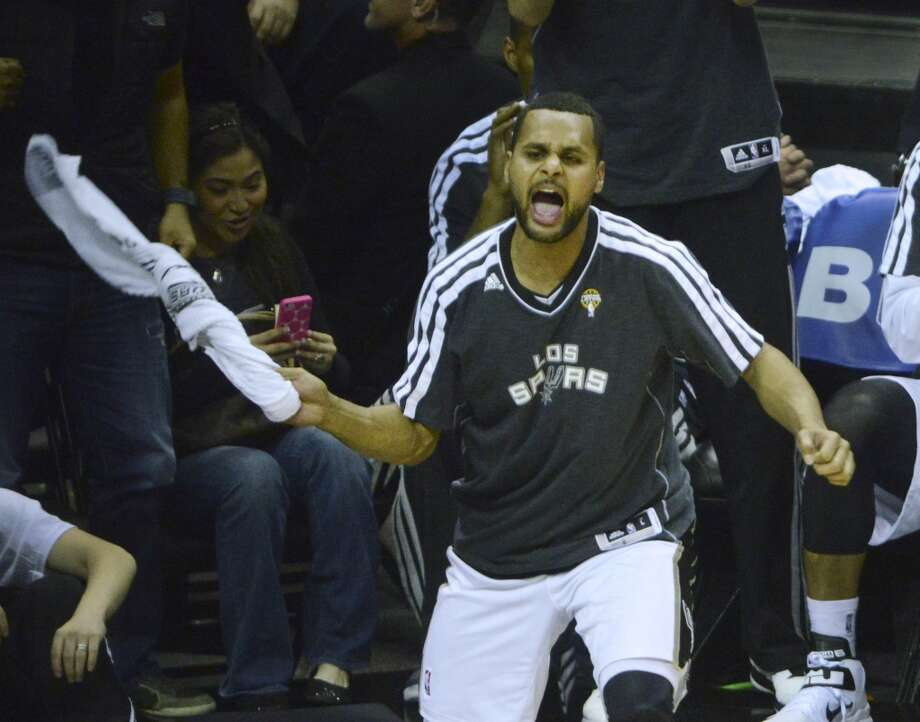 Patty Mills finds time to wave his towel in support of his Spurs teammates despite playing 22 minutes and scoring 13 points against the Bulls in the Spurs' 101-83 victory at the AT&T Center on March 6, 2013.