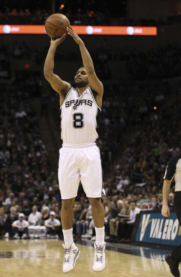 the Spurs' Patty Mills (8) shoots a 3-pointer against the Sacramento Kings at the AT&T Center on March 1, 2013. Spurs defeated the Kings, 130-102.