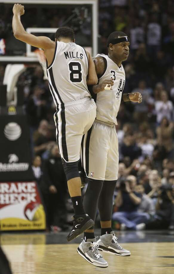 The Spurs' Patty Mills celebrates with Stephen Jackson after Jackson scored a 3-pointer against the Minnesota at the AT&T Center on Jan. 13, 2013. The Spurs won 106-88.