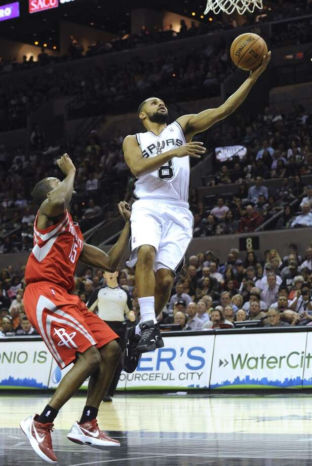 Patty Mills of the Spurs drives to score against the Rockets on Dec. 7, 2012.