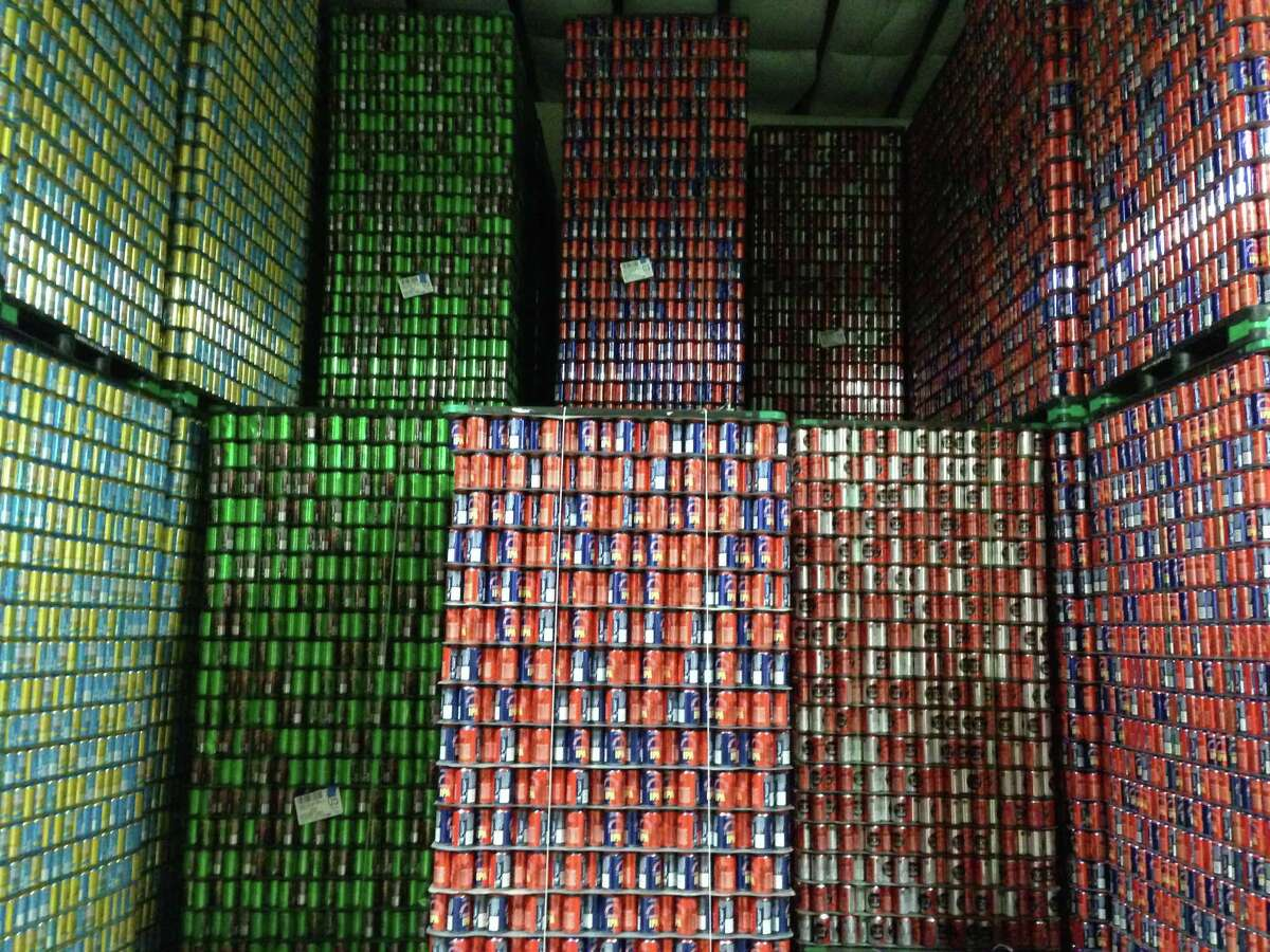 Pallets of empty cans in storage at Karbach Brewing Co. June 2013.