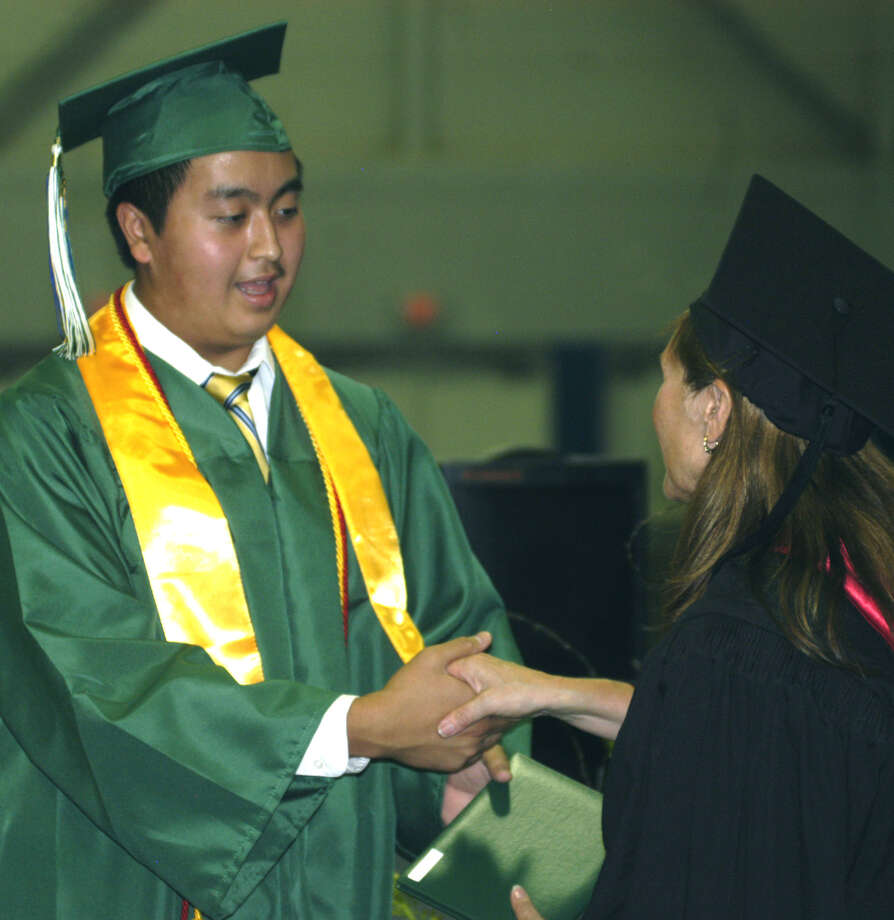 Tim Mondonedo receives his diploma from Board of Education chairwoman Wendy Faulenbach during New Milford High School's commencement exercises at the O'Neill Center on the campus of Western Connecticut State University in Danbury. June 22, 2013 Photo: Norm Cummings