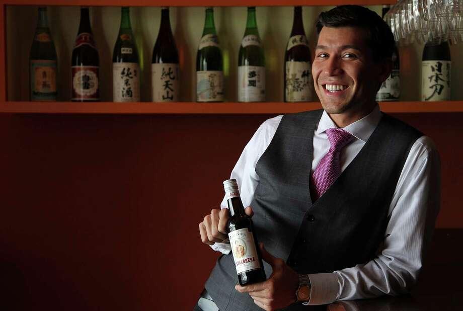 "Steven E. Salazar of Kata Robata Sushi & Grill calls La Cigarrera D.O. Manzanilla Dry Sherry ""the perfect accompaniment"" for his favorite snacks. Photo: Mayra Beltran, Staff / © 2013 Houston Chronicle"