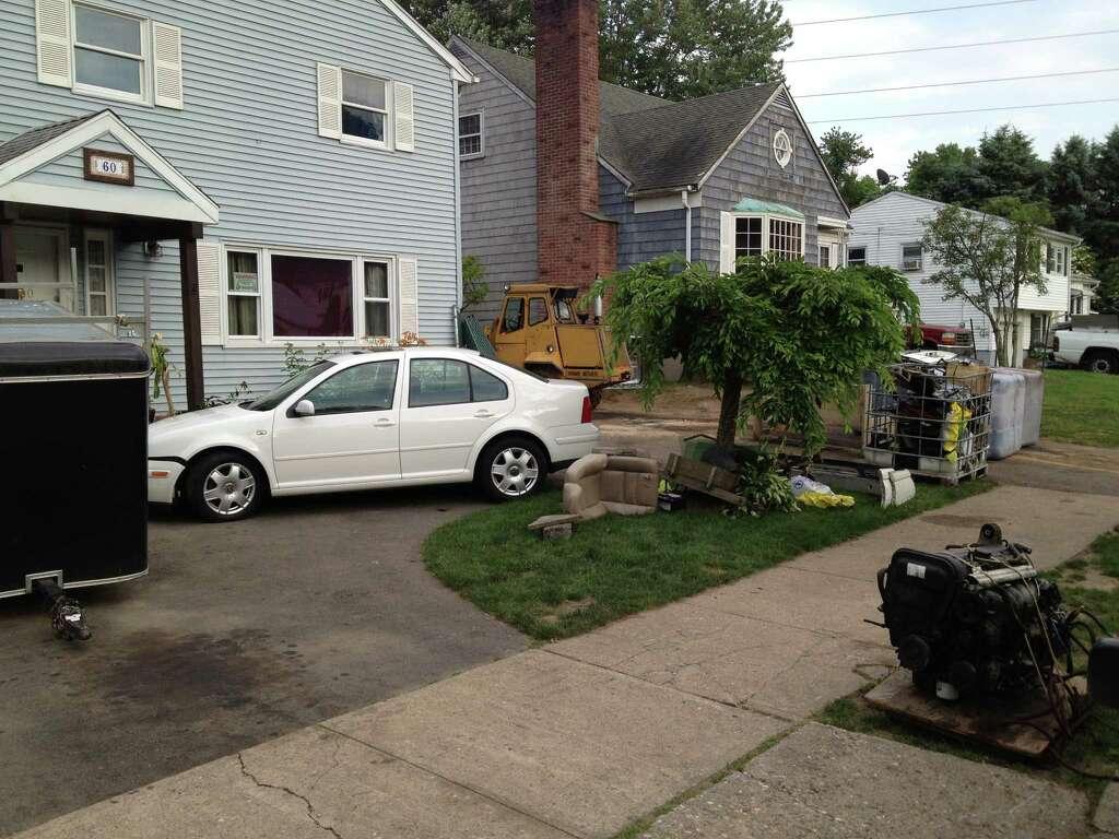 police say man had junkyard in backyard connecticut post