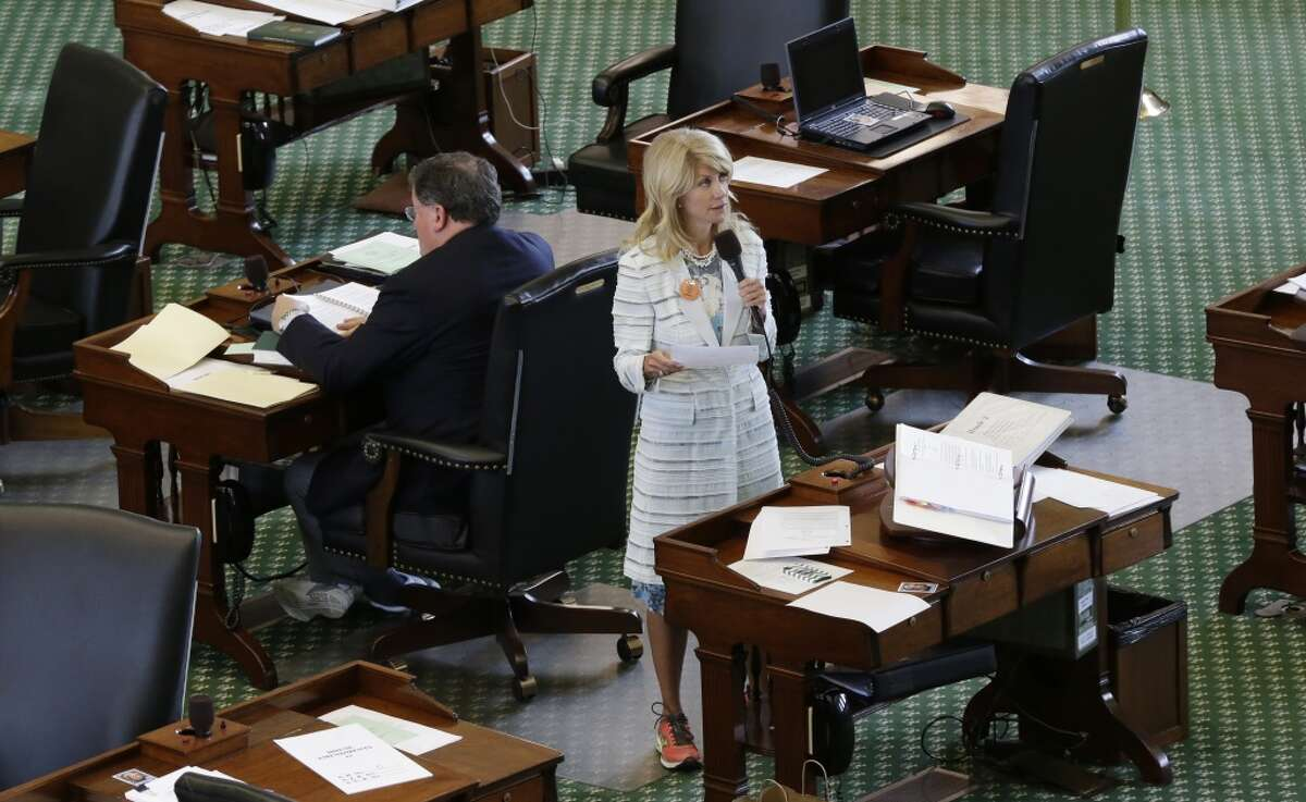 Sen. Wendy Davis, D-Fort Worth, rocks the pink sneakers for both comfort and to make a political statement during her filibuster at the Texas Capitol.