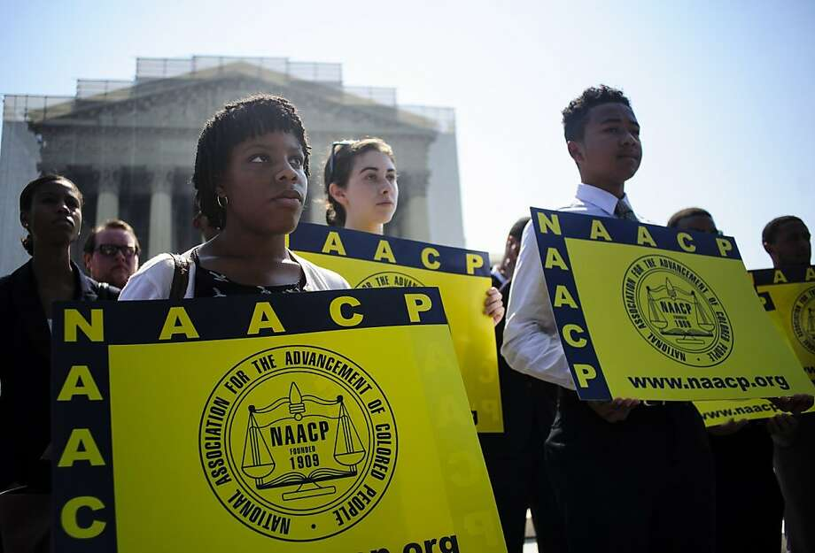 Jessica Pickens, 19, of Chicago stands with voting rights activists outside the Supreme Court, which struck down a key provision of the landmark 1965 law. Photo: Pete Marovich, McClatchy-Tribune News Service