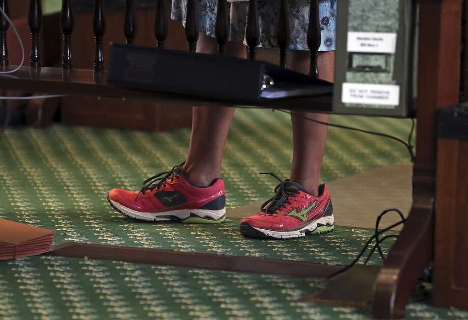 She wore pink Mizuno Wave Rider running shoes instead of her usual high heels to delay the approval of legislation that imposed stricter standards for abortions in Texas. Photo: TOM REEL, San Antonio Express-News