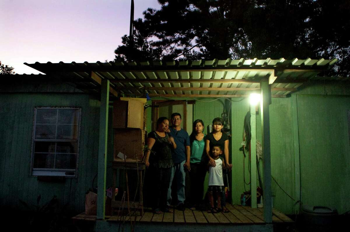 Salvador Tipaz, seen here with his family outside their Humble home in 2012, lost two nephews en route to his home from Guatemala when they and 13 others were killed in wreck outside Goliad, Texas. Junkans says the status quo of blocking the path to legalization forces many immigrants to hide in the shadows.