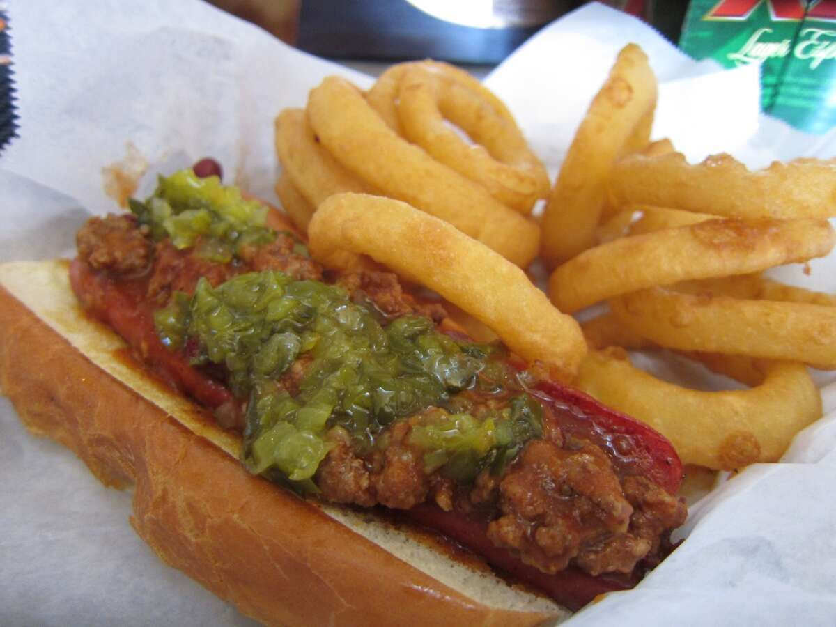 A chili dog (yes, that's a bean you spy) and onion rings at The Refinery, 702 W. Dallas.