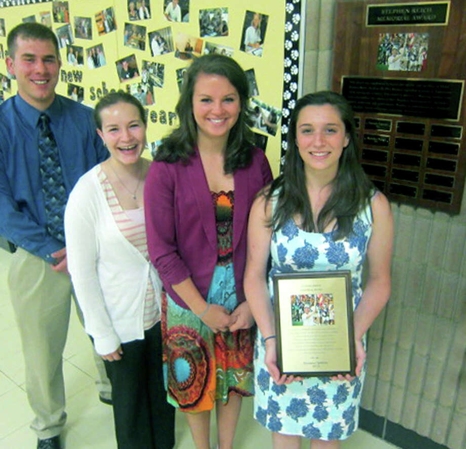 Kate DeWitte proudly holds the Stepehn Reich Memorial Award, given annually for eight years to a Shepaug Valley High School senior. Joining her following May 23's ceremony at the school are past recipients Ethan LaBella, Megan Woodruff and Alexandra Moravsky. May 23, 2013 Photo: Norm Cummings