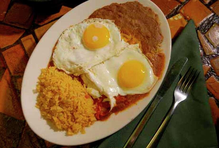 100. SPANISH VILLAGE: Cheese enchiladas with eggs.   (Cristobal Perez  : 29-95) Photo: Christobal Perez, Houston Chronicle / Houston Chronicle