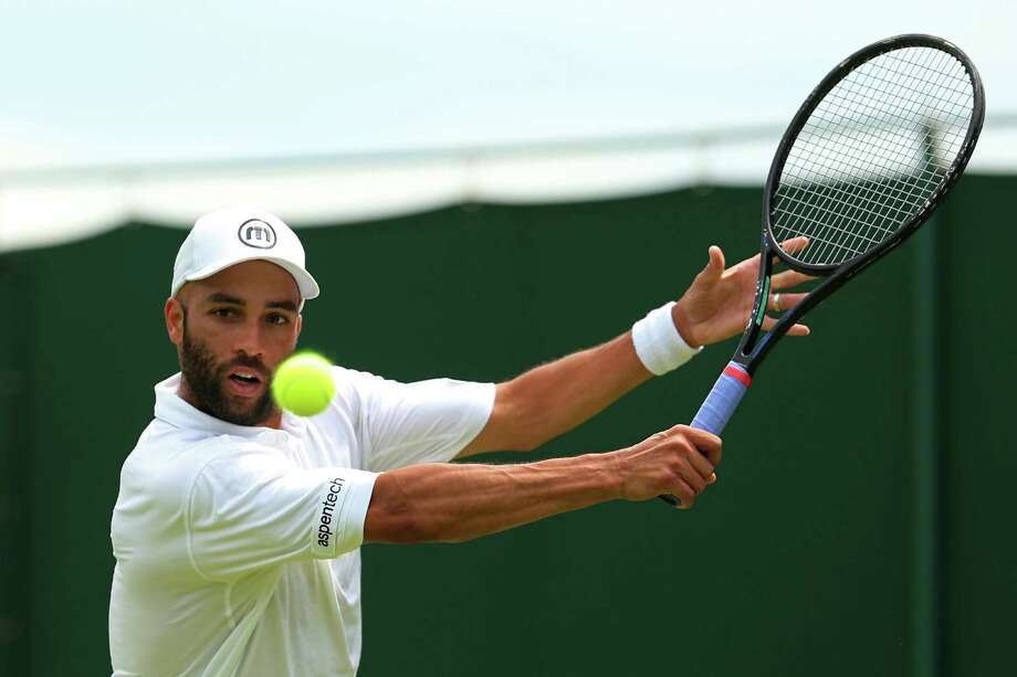 LONDON, ENGLAND - JUNE 25:  James Blake of the United States of America plays a backhand during his Gentlemen's Singles first round match against Thiemo De Bakker of Netherlands on day two of the Wimbledon Lawn Tennis Championships at the All England Lawn Tennis and Croquet Club on June 25, 2013 in London, England. Photo: Julian Finney, Getty Images / 2013 Getty Images