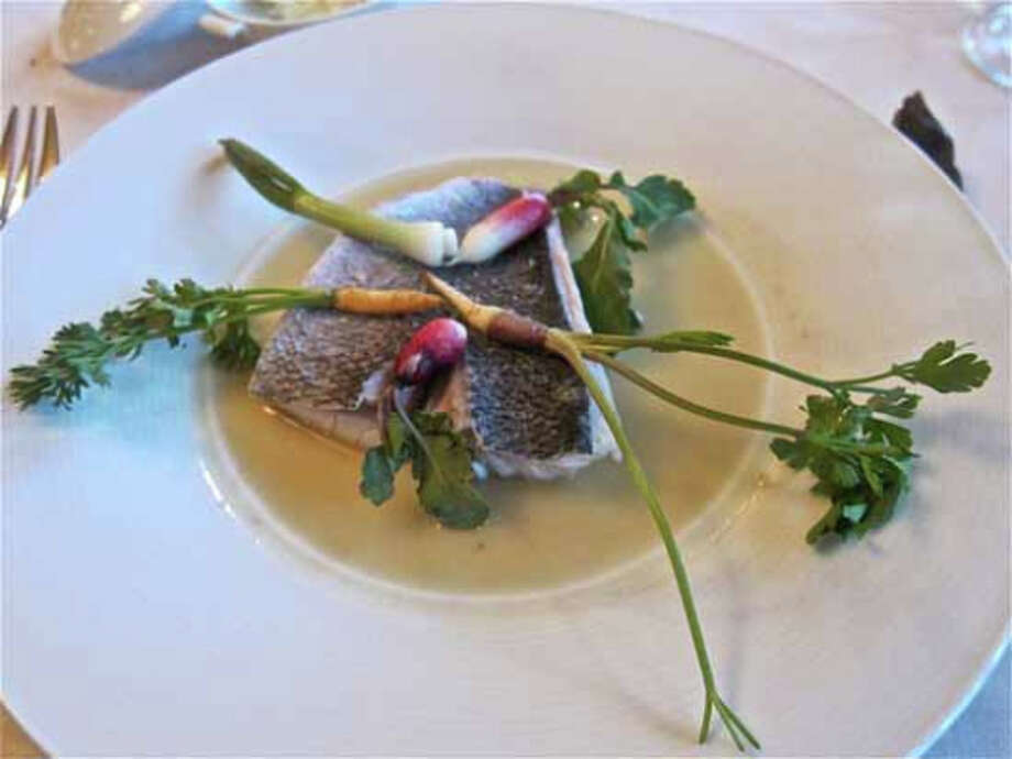 Poached orata (dorade) in a bergamot broth with spring vegetables at Ristorante Cavour Photo: Alison Cook