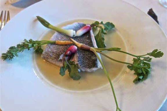 79. RISTORANTE CAVOUR: poached orata (dorade) in a bergamot broth with spring vegetables.  (Alison Cook : 29-95)