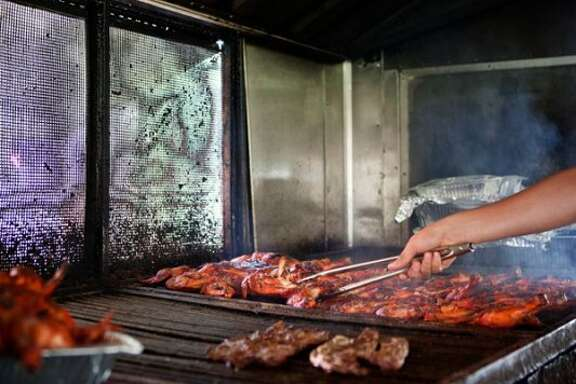 60. KARANCHO'S: lunch is on the grill in Channelview.   (Todd Spoth photo)