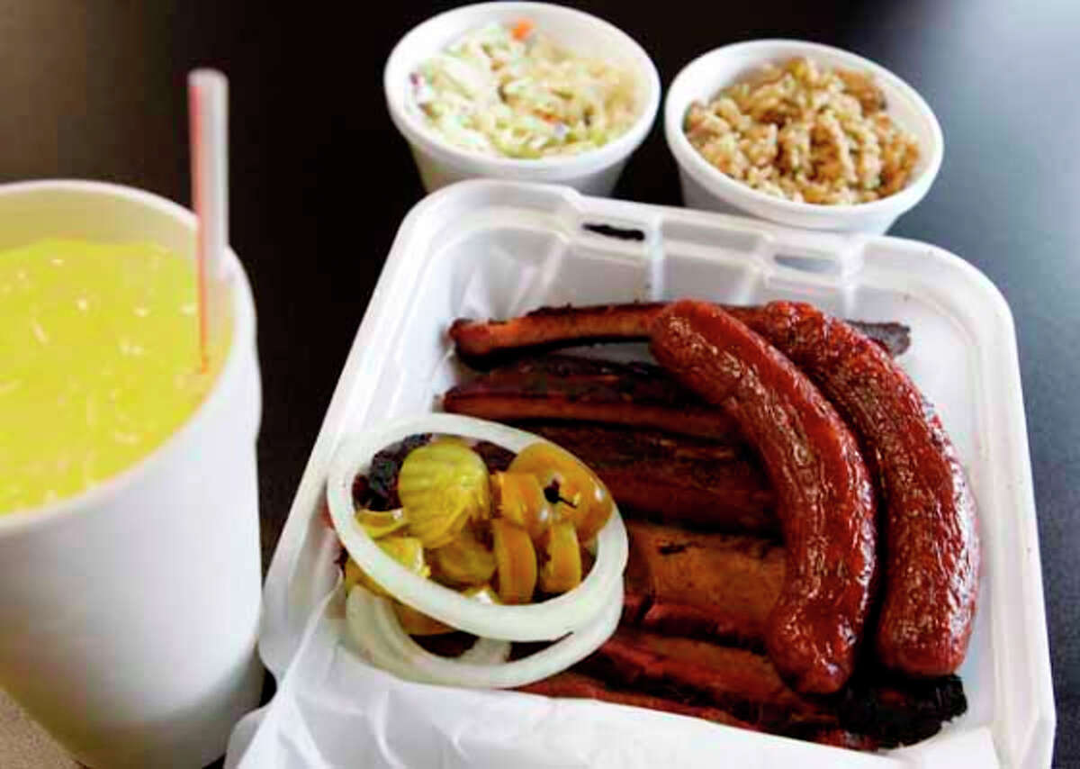 A Three meat plate with slaw, dirty rice and lemonade at Gatlin's BBQ.