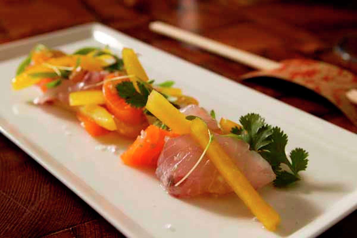 Uchiviche is salmon, striped bass, tomato, bell pepper, garlic and cilantro at Uchi.