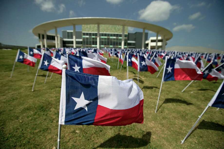 More than 1,100 flags at the Long Center in Austin last year represent the number of Texans lost each year to alcohol-related crashes.  Photo: File Photo, Austin American-Statesman / American-Statesman