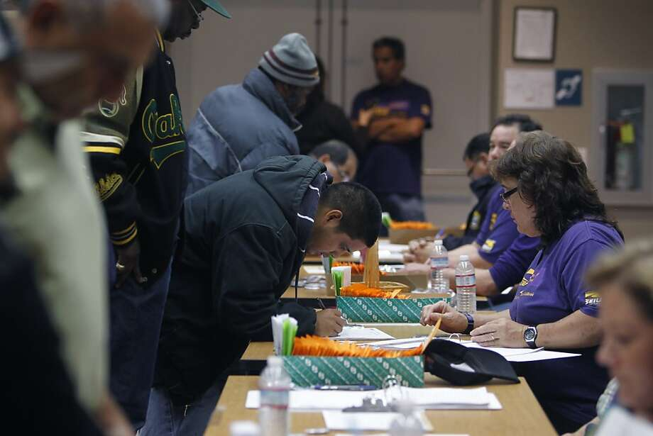 BART employees represented by SEIU Local 1021 sign in to cast their ballots in a strike authorization vote in Oakland. Photo: Paul Chinn, The Chronicle