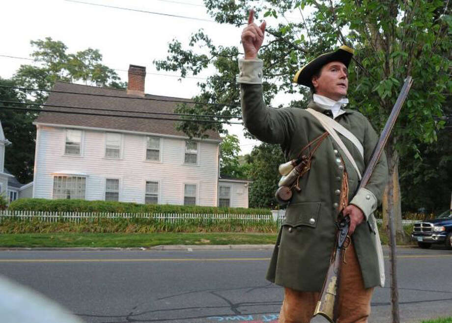The July 7, 1779, burning of Fairfield by the British is recounted by Walter Matis, from the Fairfield Museum, during last year's tour. The tour takes place July 7, rain or shine. Photo: Contributed Photo