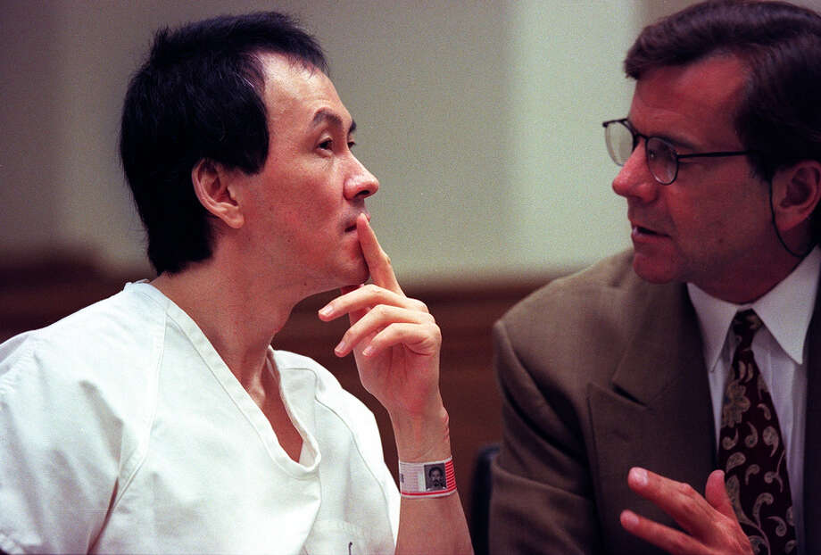 Martin Pang sits in King County Superior Court and confers with his lawyer,  John Henry Browne, before oral arguments in this file photo from 1997. Photo: ELLEN M. BANNER, SEATTLEPI.COM FILE / SEATTLEPI.COM FILE
