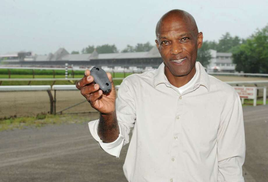 Michael Jones holds a OJonesCam,O at the Saratoga Race Course on Tuesday, June 25, 2013 in Saratoga Springs, N.Y. Jones developed a video camera which he plans to deploy on jockey's helmets during the upcoming meet in Saratoga pending final approval. (Lori Van Buren / Times Union) Photo: Lori Van Buren / 00022965A
