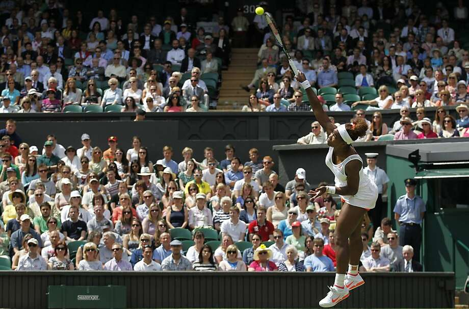 Serena Williams serves to Mandy Minella in their first-round singles match at Wimbledon. Williams went on to win 6-1, 6-3 over the 92nd-ranked Minella. Photo: Sang Tan, Associated Press
