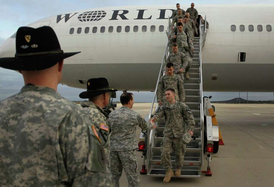FORT HOOD, TX - DECEMBER 16:  U.S. Army soldiers from the 2-82 Field Artillery, 3rd Brigade, 1st Cavalry Division, walk off the plane as they arrive at their home base of Fort Hood, Texas after being part of one of the last American combat units to exit from Iraq on December 16, 2011 in Fort Hood, Texas. The U.S. military formally ended its mission in Iraq after eight years of war and the overthrow of Saddam Hussein.  (Photo by Joe Raedle/Getty Images) Photo: Joe Raedle, Staff / 2011 Getty Images