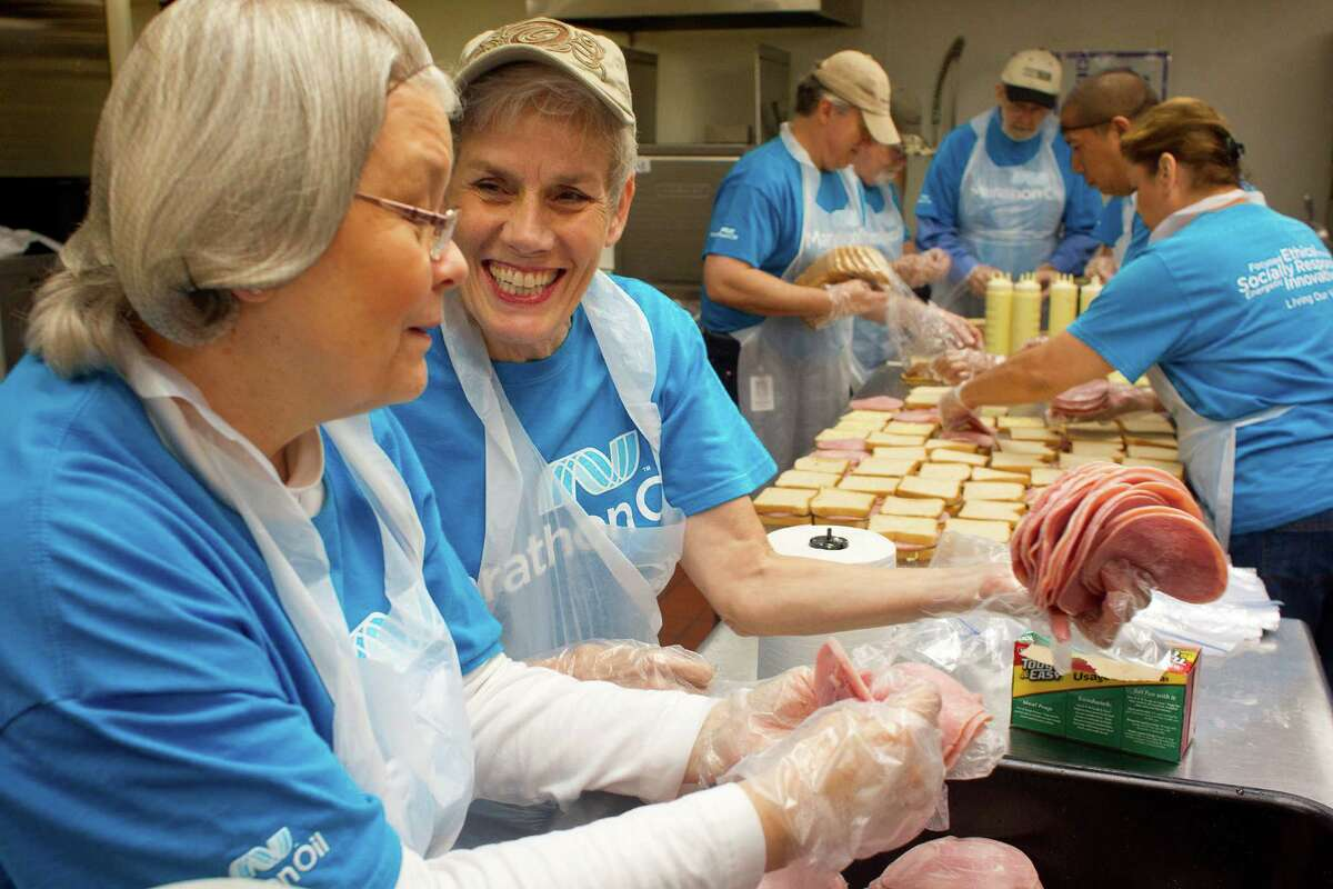 Valerie Laubacher, left, and Janis Ward, volunteers from Marathon Oil, make prepared lunches that will be delivered to preschool aged children living in poverty from the organization Kids' Meals Tuesday, June 25, 2013, in north Houston. Kid's Meals' mission is to end hunger among preschool aged children living in poverty. More than 1,700 lunches complete with a sandwich, fruit, and milk are delivered a day. In the summer, with their older siblings home from school, 2,300 meals are delivered a day. For more information about Kid's Meals, visit: www.kidsmealshouston.org The Annie E. Casey Foundation's Kids Count report released Monday, places the overall well-being of Texas children in the bottom 10 of it's overall rankings at 42nd out of the 50 states based on economic, education, health, family and community. The ranking is up two spots from last year's 44th ranking. In the study's family and community section, Texas ranked 48th, economic, 30th, education, 31st, and health, 36th, up from 42nd the year before.