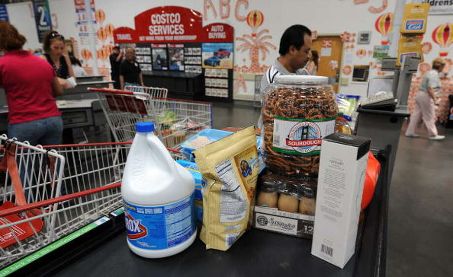 Hate:  Having to use your debit card for that bargain. Shopping on credit just feels less painful financially. Photo: GABRIEL BOUYS, AFP/Getty Images / 2008 AFP