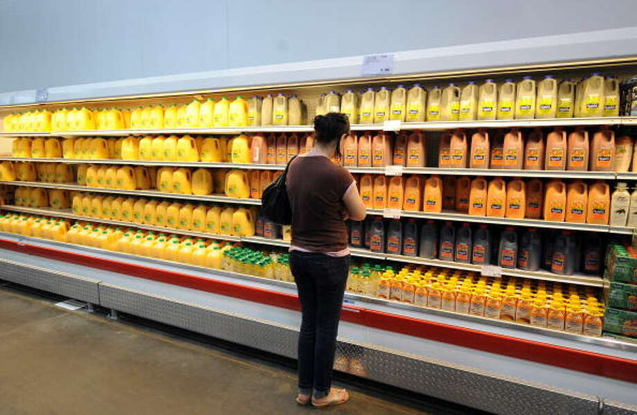 Love: How you can get everything at Costco, from orange juice to... Photo: GABRIEL BOUYS, AFP/Getty Images / 2008 AFP