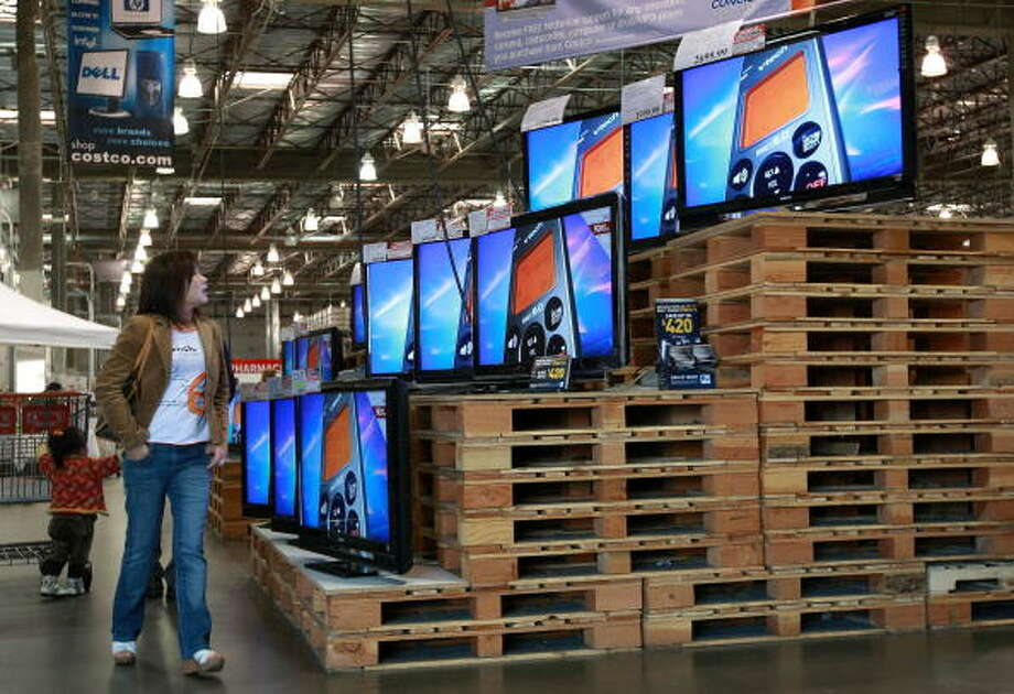 Love: ... flat-screen TVs, to ... Photo: Justin Sullivan, Getty Images / 2008 Getty Images