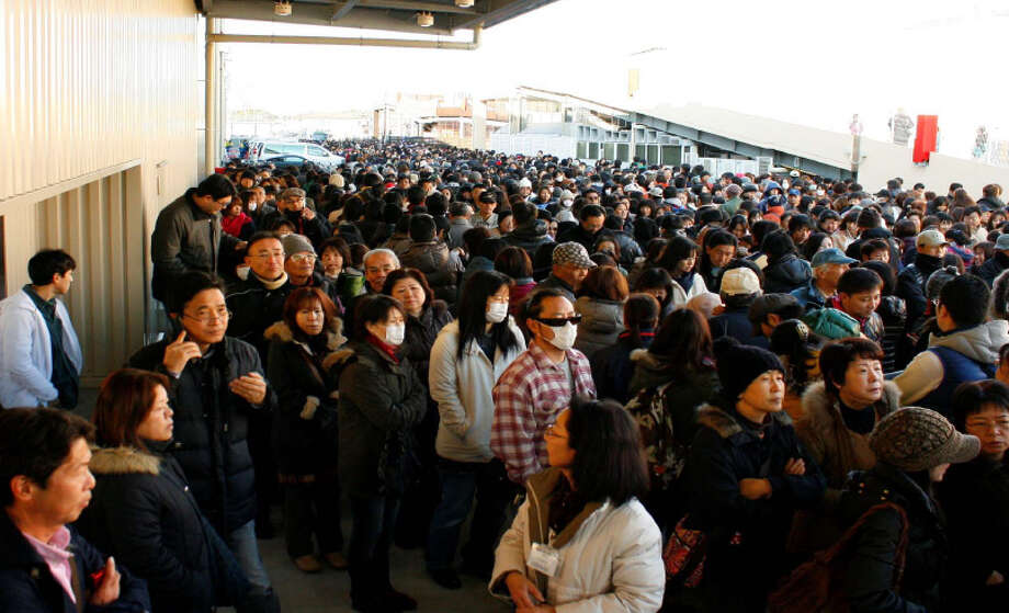 If you think the Seattle Costco on Fourth Avenue South is a zoo on Saturdays, at least it doesn't look like this crowd at the Costco in Zama, Japan. The warehouse was one of 17 opened in fiscal 2012. Photo: Photo Courtesy Costco