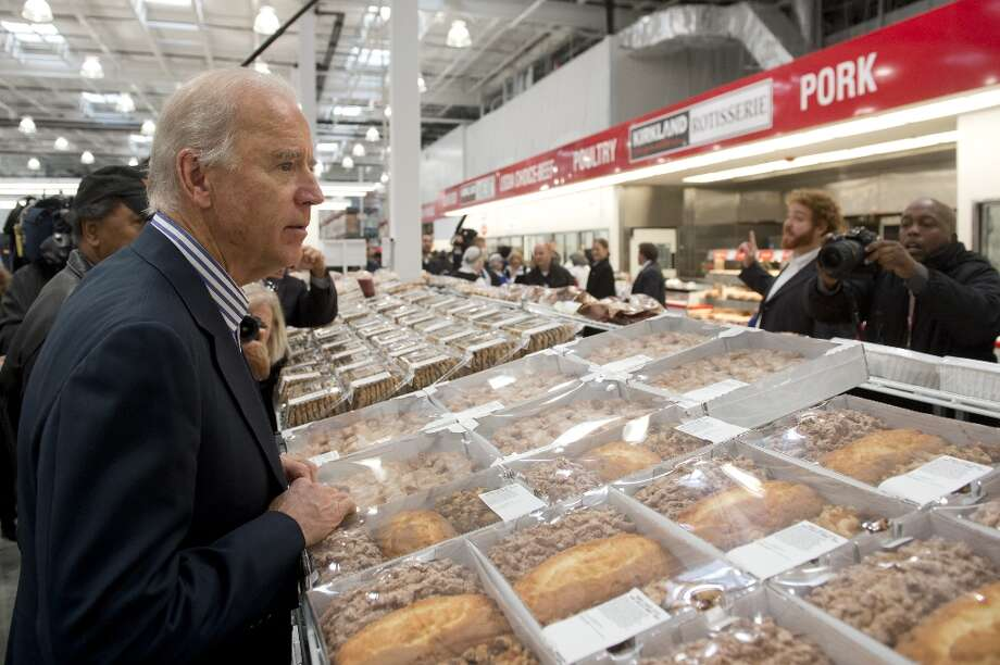 Vice President Joe Biden created some buzz last November when he visited Costco's grand opening in Washington, D.C., where he scanned the pie aisle. Those pies and other baked goods were worth $1.3 billion in sales for Costco. Photo: SAUL LOEB, AFP/Getty Images / 2012 AFP