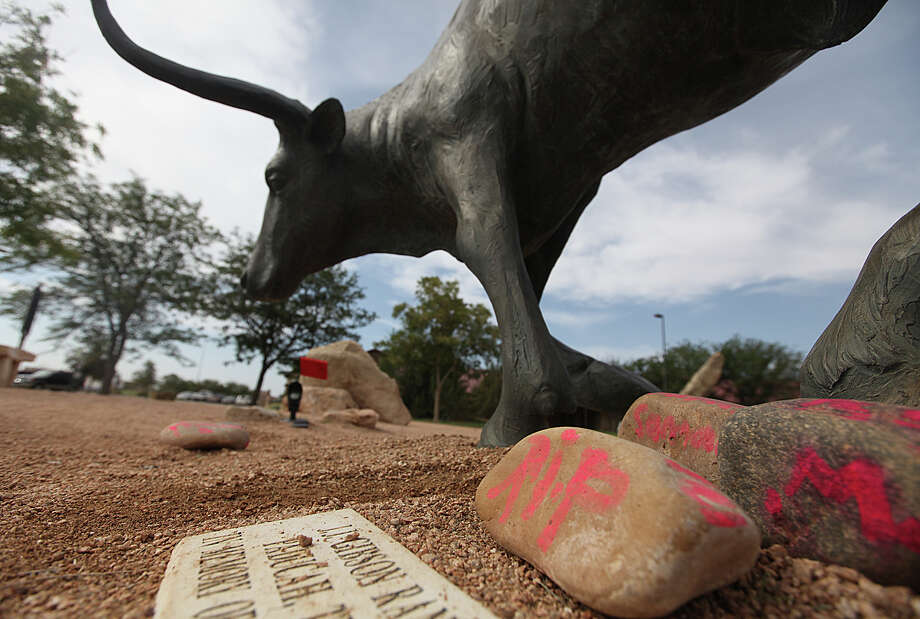 Memorials rest at the feet of a longhorn statue at the National Ranching Heritage Center in Lubbock where 14-year-old Miguel Martinez died in an accident. He ran into the bull statue while playing hide-and-seek. Photo: Zach Long, MBI / Lubbock Avalanche-Journal