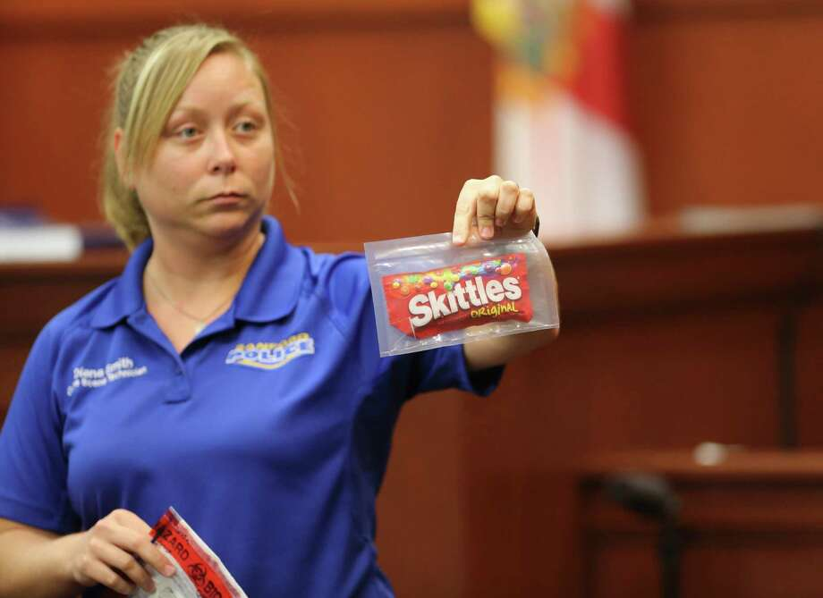 Diana Smith, crime scene technician for the Sanford Police Department, shows a bag of candy, which was collected as evidence, to the jury during George Zimmerman's trial in Seminole circuit court in Sanford, Fla. Tuesday, June 25, 2013. Zimmerman has been charged with second-degree murder for the 2012 shooting death of Trayvon Martin. (AP Photo/Orlando Sentinel, Gary W. Green, Pool) ORG XMIT: FLJR228 Photo: Gary W. Green / Pool Orlando Sentinel