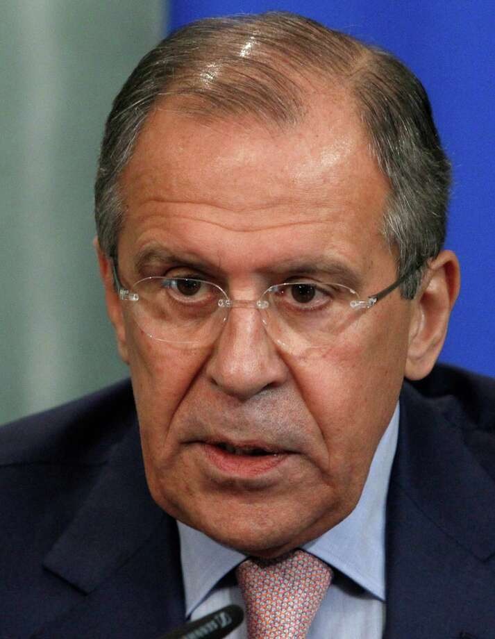 Russia's Foreign Minister Sergey Lavrov speaks at a news conference in Moscow on Tuesday, June 25, 2013. Lavrov on Tuesday bluntly rejected U.S. demands to extradite National Security Agency leaker Edward Snowden, saying that Snowden hasn't crossed the Russian border as he seeks to evade prosecution. Sergey Lavrov insisted that Russia has nothing to do with Snowden or his travel plans. Lavrov wouldn't say where Snowden is, but he angrily lashed out at the U.S. for demanding his extradition and warnings of negative consequences if Moscow fails to comply.  (AP Photo/Ivan Sekretarev) Photo: Ivan Sekretarev