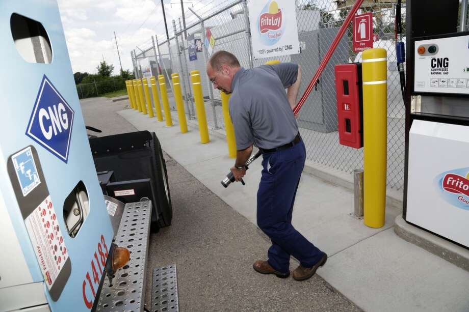 Frito-Lay employee Dan Walsh uses the company's compressed natural gas fueling station last week in Beloit, Wis. Photo: Darren Hauck