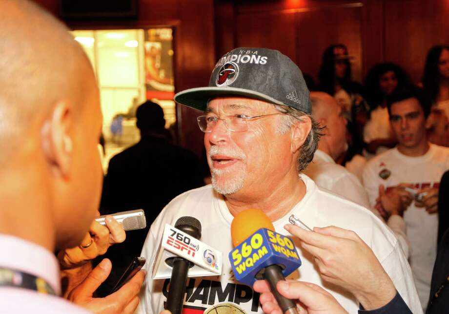FILE - JUNE 25, 2013:  It was reported that Carnival Corp, despite an increase in profits to $41 million in the second-quarter, CEO Micky Arison is being replaced by Arnold W. Donald June 25, 2013.  MIAMI, FL - JUNE 21:  Team Owner Micky Arison of the Miami Heat is interviewed in the locker room after they won 121-106 against the Oklahoma City Thunder in Game Five of the 2012 NBA Finals on June 21, 2012 at American Airlines Arena in Miami, Florida. NOTE TO USER: User expressly acknowledges and agrees that, by downloading and or using this photograph, User is consenting to the terms and conditions of the Getty Images License Agreement.  (Photo by Mike Ehrmann/Getty Images) Photo: Mike Ehrmann, Staff / 2012 Getty Images