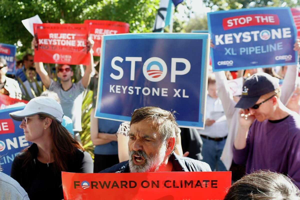 Protesters who oppose the Keystone XL pipeline demonstrate near an appearance by President Barack Obama this month in California. On Tuesday he set a condition for the project's fate.