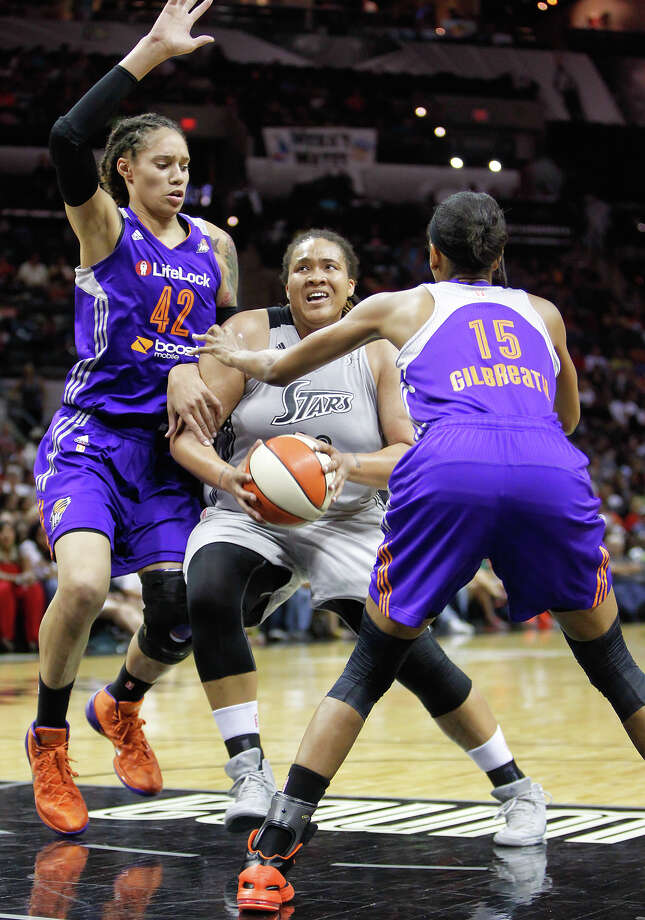 Danielle Adams (center) tries to go up for a shot between Phoenix's Brittney Griner (left) and Briana Gilbreath during the first half of the Silver Stars game with the Phoenix Mercury at the AT&T Center on Tuesday, June 25, 2013.  The game was former Baylor standout Brittney Griner's first trip to play in her home state. The Mercury won the game 83-77.   MARVIN PFEIFFER/ mpfeiffer@express-news.net Photo: MARVIN PFEIFFER, Marvin Pfeiffer/ Express-News / Express-News 2013