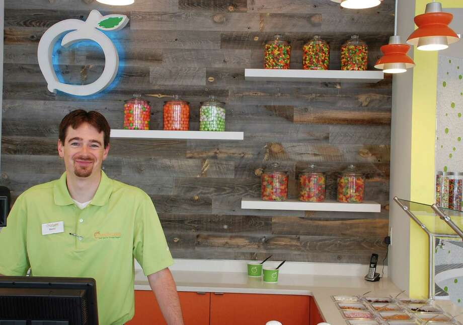 Shawn Clifford, a consultant for Peachwave Frozen Yogurt, at the chain's new store on Post Road West. Photo: Jarret Liotta / Westport News