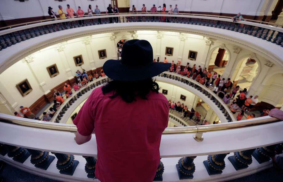 Hundreds lined up to enter the Senate Chamber spills into multiple levels of the rotunda as Sen. Wendy Davis, D-Fort Worth, filibusters in an effort to kill an abortion bill, Tuesday, June 25, 2013, in Austin, Texas. The bill would ban abortion after 20 weeks of pregnancy and force many clinics that perform the procedure to upgrade their facilities and be classified as ambulatory surgical centers. Photo: Eric Gay, Associated Press / AP