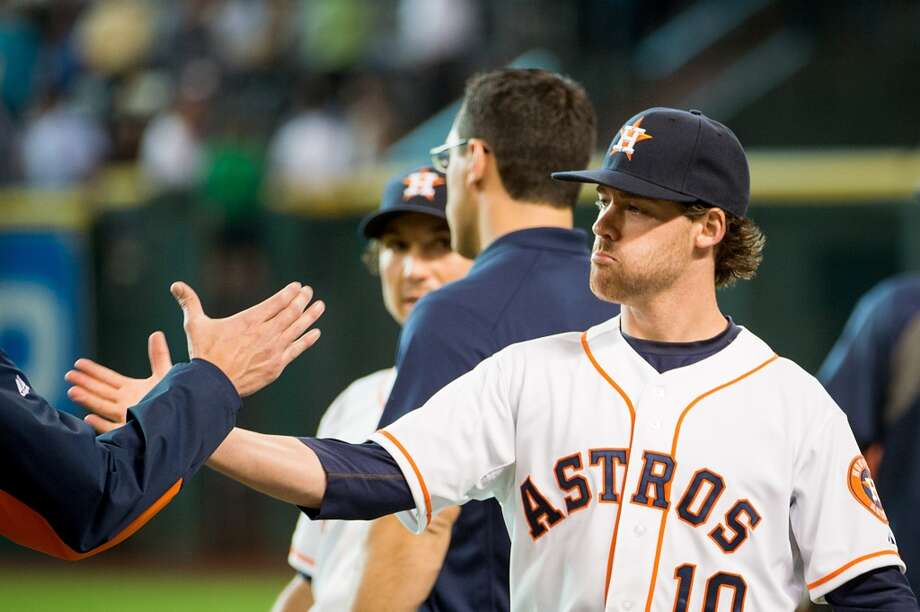 Astros second baseman Jake Elmore shakes hands with teammates before a game against the Cardinals. The Astros officially recalled infielder Elmore and Brett Wallace on Tuesday from Class AAA Oklahoma City.