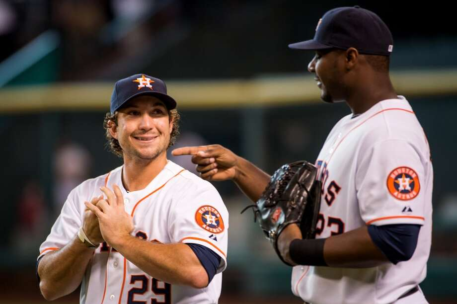 Astros first baseman Brett Wallace laughs with Chris Carter before a game against the Cardinals. The Astros officially recalled infielder Jake Elmore and Wallace on Tuesday from Class AAA Oklahoma City.