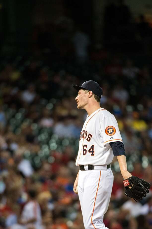 Astros starting pitcher Lucas Harrell reacts after giving up a single to Cardinals catcher Yadier Molina during the fourth inning