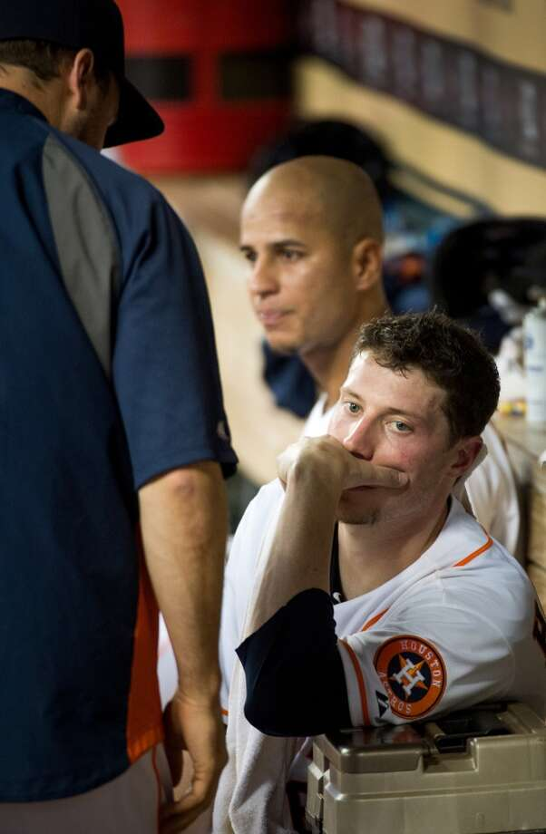 Astros pitcher Lucas Harrell watches from the bench after being pulled in the fourth inning.