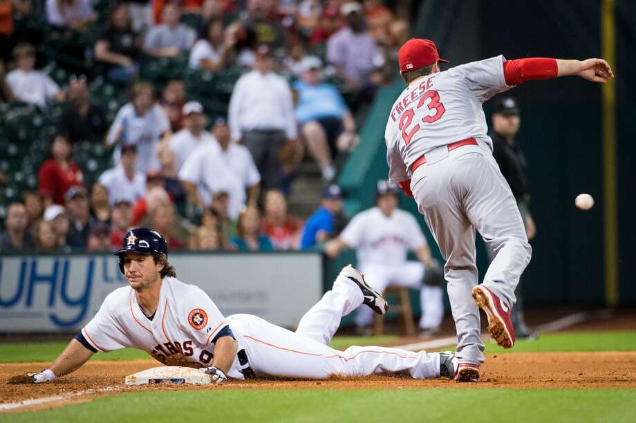 Astros first baseman Brett Wallace is safe at third base after hitting a two-run triple.